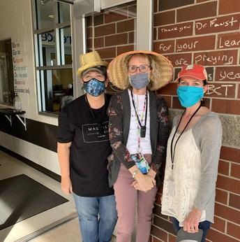 three teachers in their hats