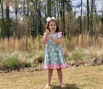 Evelyn waving her Palm Branch