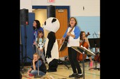 Mrs. Hayes and our PANDA leading us in song!