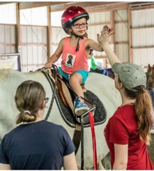 Work Based Learning -  Abigail Adamczyk giving high fives at The Therapeutic Equestrian Center of Holyoke