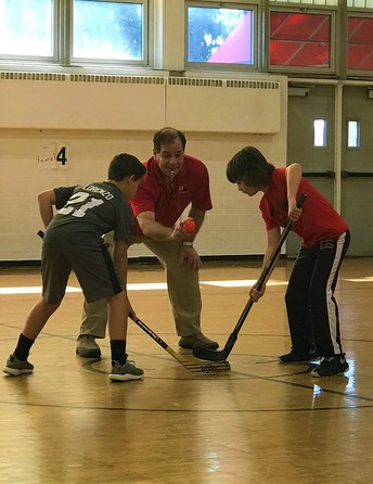 6th Graders Enjoying a Great Late Winter of Floor Hockey Action