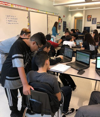 @mr_reimerESOL has his class working on IXL math problems together!