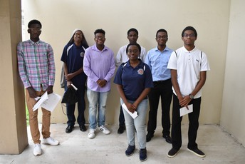 A group picture of the interns that shows 6 boys and one girl from Blanche Ely High School & Stranahan High School