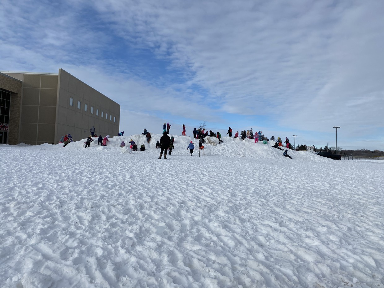 Playing on snow hills are great fun for kids!