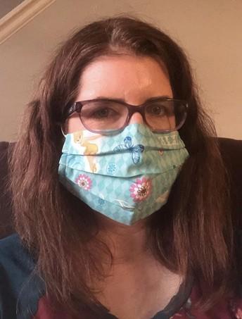 Amy Platt wears a Tinkerbell mask - slow the spread of COVID-19.