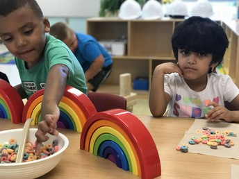 Matching our snack to the colors in the rainbow - all on our own!