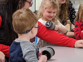Tiny Toppers Preschool Students Explore Cabasa Musical Instruments During Music Lesson