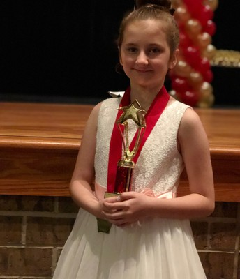 LPS third-grader, Riley Showman,  received a trophy for her performance in Junie B. Jones