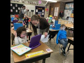 Mrs. Smith helping a different Kindergarten friend