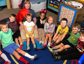 Ms. Cheryl's Kindergarten Class spotlighting the letter S with fun socks!
