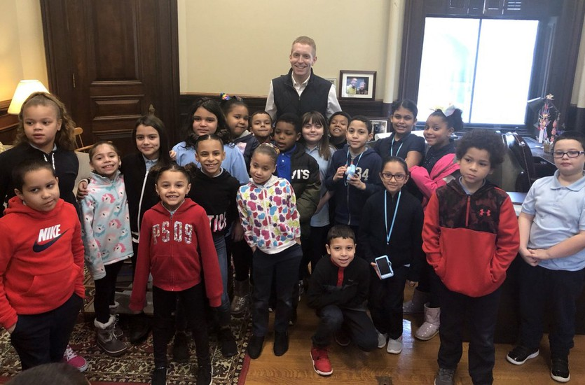 Kelly School third-graders pose for a photo with Mayor Alex Morse