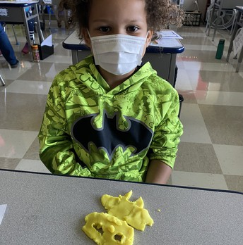 Student with Play-Doh Creation