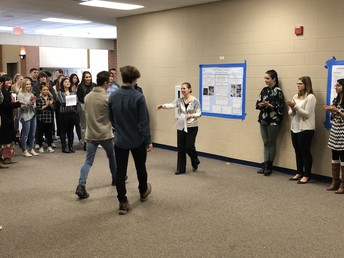 Mrs. Bunce presents awards at the end of the research poster fair