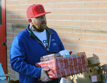 Bonanza Principal Jordan Osborn delivered gifts to families, covering a 200-mile route on Friday