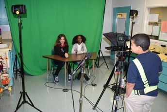 Students filming the morning show using their new equipment
