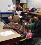 DB Football Players Read with Jackson Braves!
