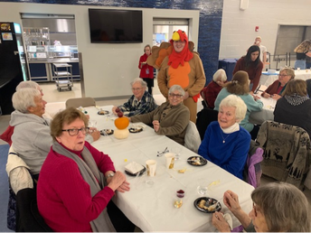 Students, faculty, and volunteers at MRHS host Thanksgiving dinner for senior citizens