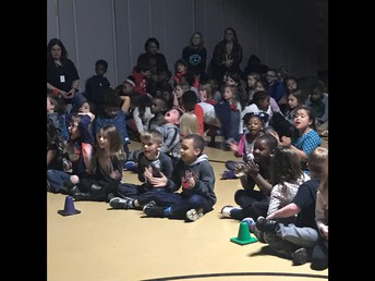 Our Children Cheering on Their Classmates