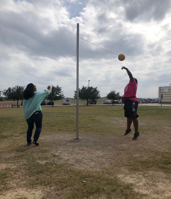 Mrs. Diaz (Kinder) and Mrs. Vicki (PE) play a friendly game of tetherball afterschool!