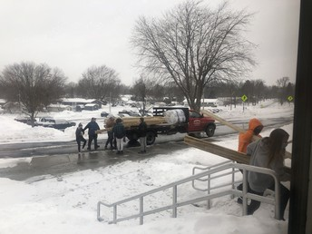 Technology classes get ready to make picnic tables for the courtyard.