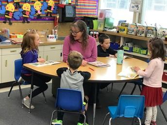 Ms. Kardona running reading groups - even on Valentine's Day!