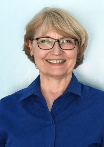 Picture of Dr. Susan Simmons, a beautiful smile, with short blonde hair, glasses and a navy shirt.