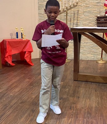4th/5th Grade Winner Elijah, reading his poem