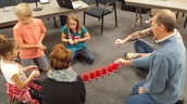 No hands, just string, rubber bands and teamwork
