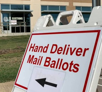 Hand delivering a ballot by mail