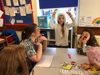 ...and they beat Mrs Bottomley at Uno!