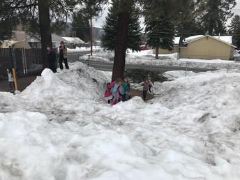 1st graders enjoying the shrinking playground snow hills