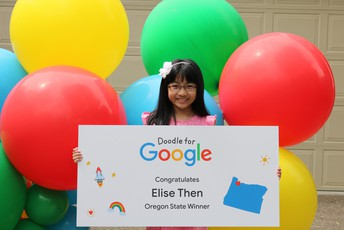 little girl (Elise Than) with balloons and winner banner