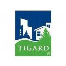 "Graphic for City of Tigard word ""Tigard"" with buildings and grass"