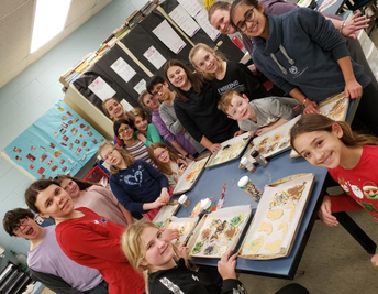 Interact Club baking cookies for 'Habitat for Humanity'