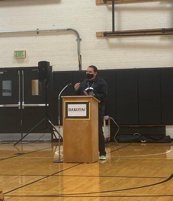 man at speaking podium