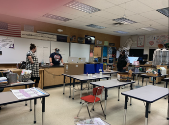 Science teachers social distance while doing labs on zoom