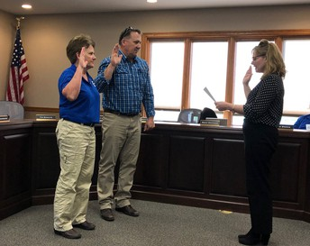 Directors Dot Schoening and Tim Schulte take oath of office