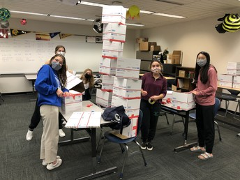 Interact students prep the mailing boxes for soldiers