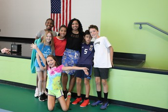 Author Tracey Baptiste posing with Talley Street students.