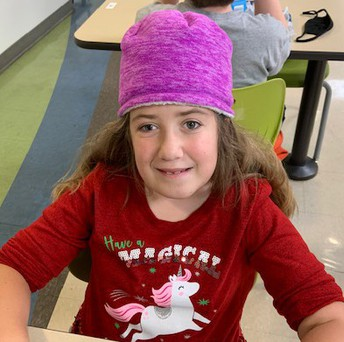 Mackenzie wearing a Magical Unicorn Christmas shirt