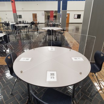 Plexiglass dividers were added to tables to provide more protection