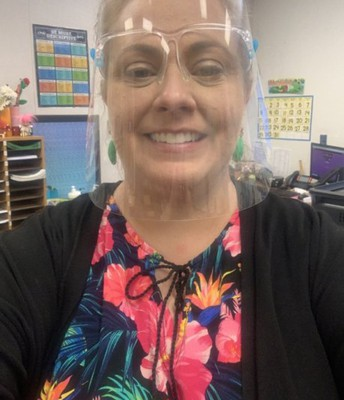 Mrs. Smedstad - Showing her spirit on Hawaiian Day!