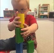 Joshua enjoying building with blocks.