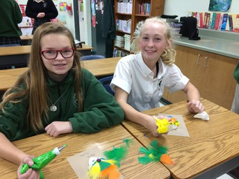 Spanish students celebrate the Day of the Dead by decorating sugar skulls