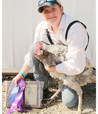 Klayton Purdy with his Grand Champion Fancy Turkey