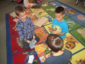 Three Students Playing a Match Up Game which helps Improve Reading and Math