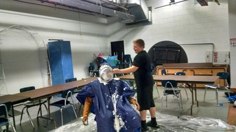 Student pieing the principal in the face
