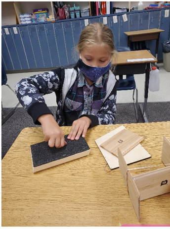 Student creating Bee House Structure in SHINE.