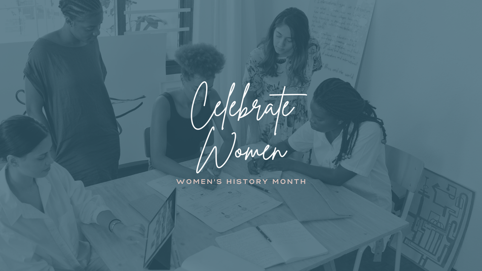 5 diverse women look at plans together.  It looks like they are business partners designing the next best thing.