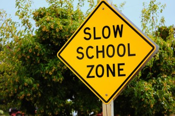 CAUTION!  Slow Down In School Zones!